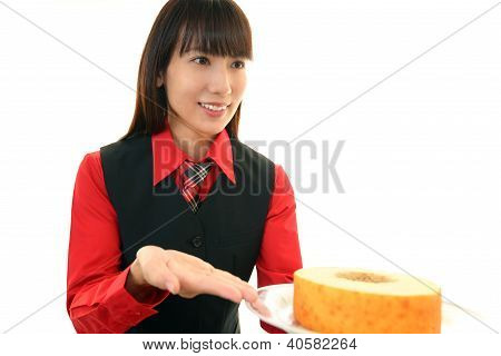 Waitress delivering sweet to table