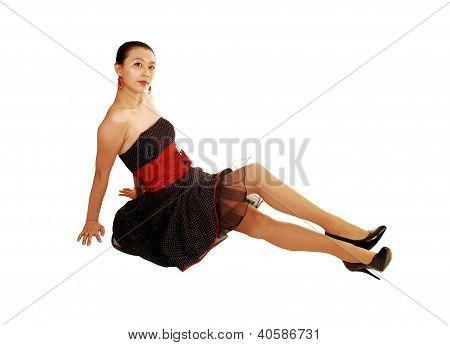 Pretty Asian Girl Sitting On Floor.