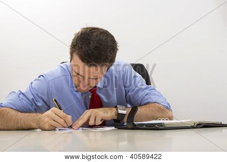 Businessman Filling Paper Documents