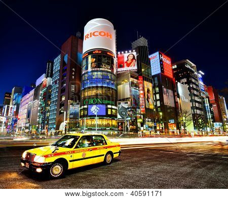 TOKYO - DECEMBER 25, 2012: A Taxi at Ginza District December 25, 2012 in Tokyo, JP. Ginza etends for 2.4 km and is one of the world's best known shopping districts.