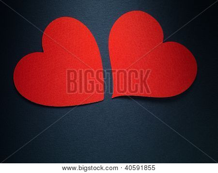 Valentine day couple hearts made of paper on blue paper background
