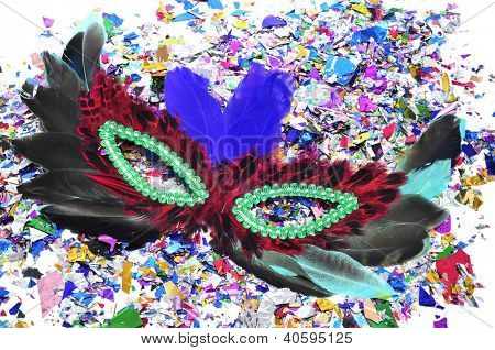 feathers carnival mask and confetti of different colors