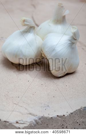 Garlic Bulbs on Natural Stone