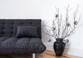 picture of futon  - Gray sofa and simple winter decorations in the living room - JPG