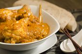 image of ayam  - Chicken Kapitan - Malaysian chicken curry with coconut milk. Traditional Nyonya cuisine.