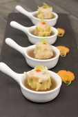 stock photo of siomai  - Siu Mai - Chinese steamed pork dumplings in hot and sour soup.