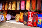 stock photo of batik  - Colourful batik textiles at Indonesian street market - JPG