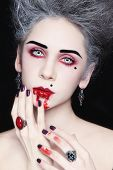 image of marquise  - Portrait of young beautiful stylish gothic woman with vintage hairdo and bloody mouth - JPG