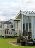 foto of trailer park  - Exterior of mobile caravan homes in modern trailer park - JPG