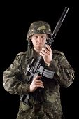stock photo of m16  - Alerted soldier raised m16 in studio - JPG