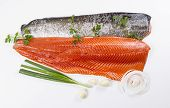 stock photo of steelhead  - Wild Pacific Salmon Fillets with fresh herbs on White background - JPG