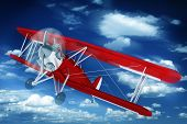 stock photo of biplane  - Red Biplane on the Sky - JPG