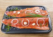 picture of steelhead  - Wild Pacific Salmon Fillets in Bake Pan with fresh herbs on Bamboo Board - JPG