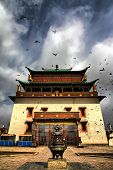 stock photo of ulaanbaatar  - Dramatic photo of Gandantegchinlin Monastry in Ulaanbaatar - JPG