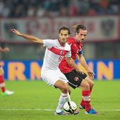 VIENNA,  AUSTRIA - AUGUST 15 Christian Fuchs (#5 Austria) and Hamit Altintop (#6 Turkey) fight for t