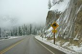 picture of rocky-mountains  - Traffic signs on icy mountain road Rocky Mountains Idaho - JPG