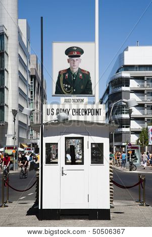 BERLIN, GERMANY - JULY 21, 2013: Checkpoint Charlie; the most famous Berlin crossing point between East and West Berlin during the Cold War