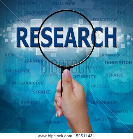 Research In Magnifying Glass On Blue Background