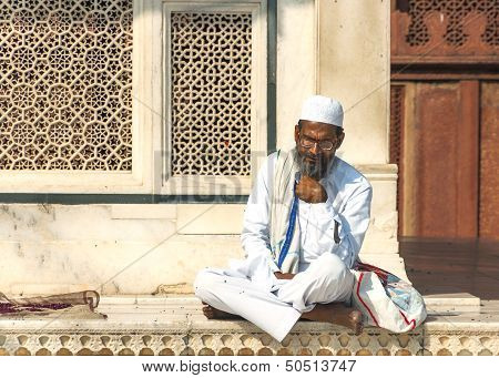 Fatehpur, India - February 2011: Sufi Muslim Cleric Studies Holy Texts at The Jama Mashid Mosque.