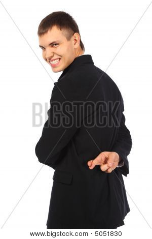 Smiling Businessman With Fingers Crossed Behind His Back