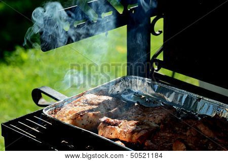 Meat Is Roasted On The Grill
