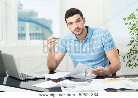 handsome young interior designer at workplace