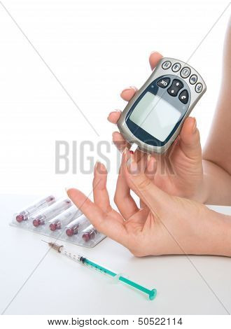 Glucose Level Blood Test Using Mini Glucometer And Small Drop Of Blood