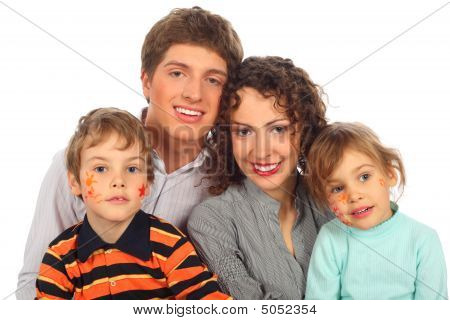 Happy Family Of Four With Paintings On Childish Faces