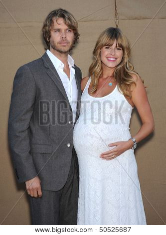 LOS ANGELES - AUG 04:  Eric Christian Olsen & Sarah Wright arrives to CBS Showtime CW All Star Winter TCA Party 2013  on July 29, 2013 in Beverly Hills, CA