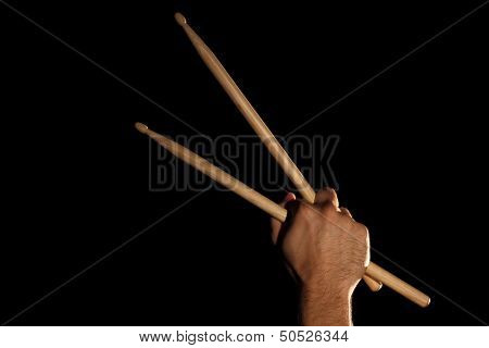 Drummer hand with drumsticks