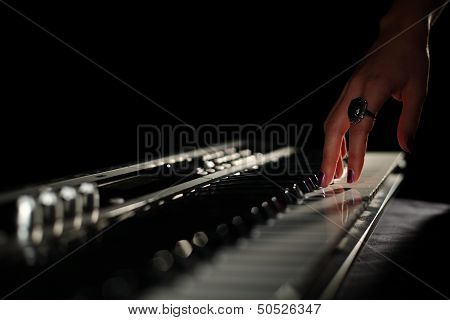 Girl hand with synthesizer