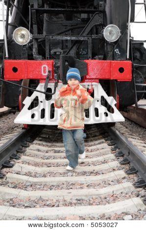 Boy Runs Before Locomotive