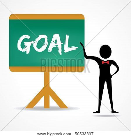 Man points to goal word on green board