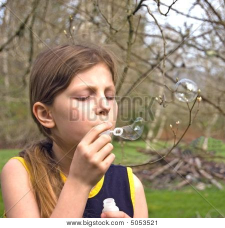 8 Year Old Blowing Bubbles