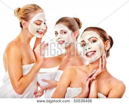 Group women with  facial mask in beauty spa.