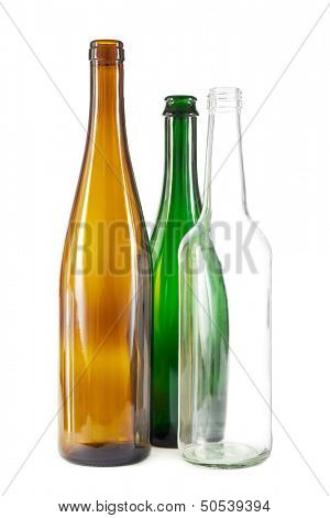 Group of brown, green and clear white glass bottles on white
