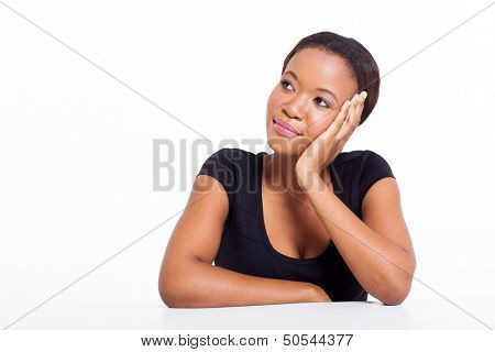 young african woman thinking isolated on white background