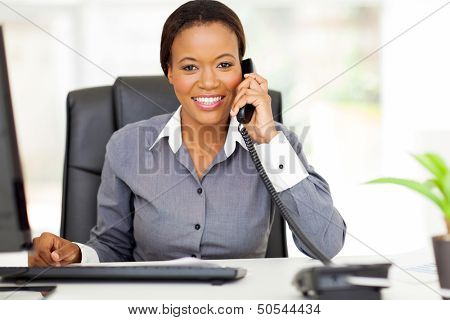 portrait beautiful african american businesswoman using landline phone