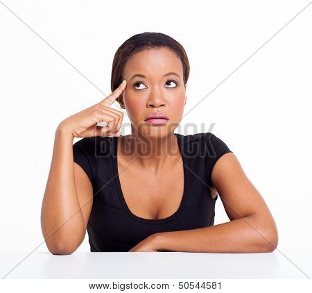 thoughtful african american businesswoman looking up on white background