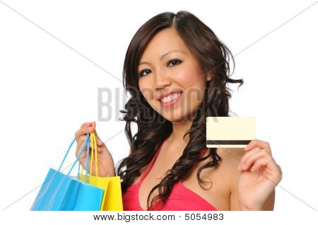 Beautiful Asian Model Posing With Shopping Bags And Credit Card