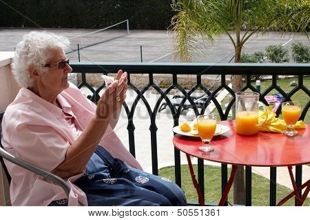 Senior Lady Wiping Her Fingers