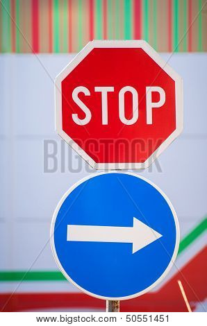 Stop And Arrow Sign