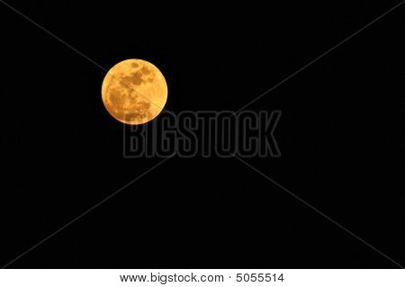 Early Full Moon As Seen From Florida With Orange Glow