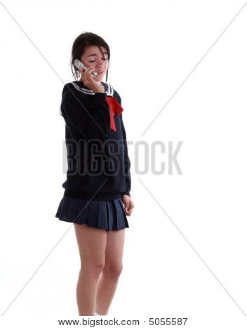 Mixed Race School Girl On Her Cell Phone