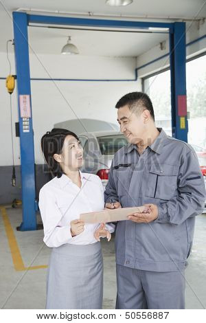 Garage Mechanic Explaining to Customer