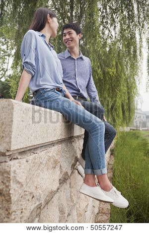 Young Couple Looking at Each Other by a Canal