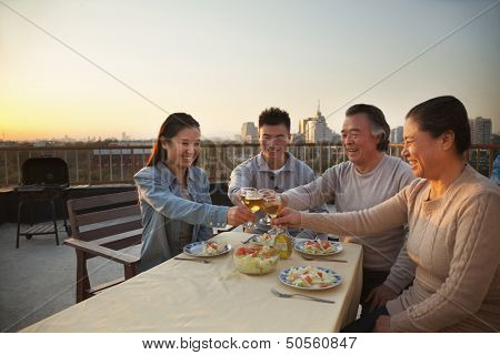 Family barbeque party, toast