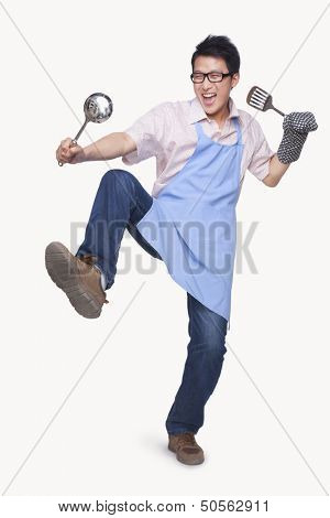 Young Man Playing with Cooking