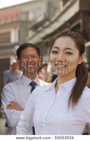 Portrait of two Business People, focus on businesswomen, outdoors, Beijing