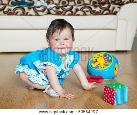 Little Girl With Toy At Home